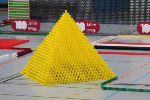 134852 Most dominoes toppled in a 3D pyramid.jpg