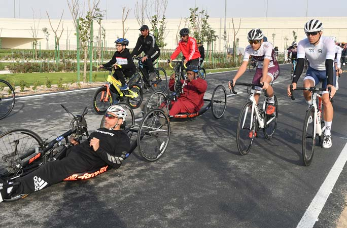 A-group-of-people-riding-their-bikes-on-the-longest-continuous-cycle-path