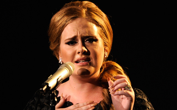 Adele scoops triple world record success in new Guinness World Records 2012 Edition
