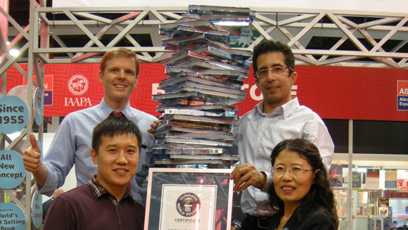 Tallest stack of Guinness World Records™ books record topples