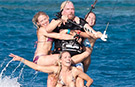 Video: Sir Richard Branson sets new record for most people riding a kitesurf board