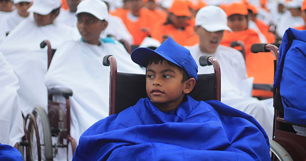 Child taking part in attempt for largest wheelchair logo India