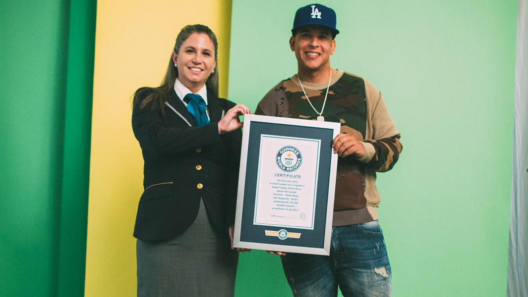 Daddy Yankee poses with a Guinness World Records adjudicator