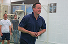 Prime Minister David Cameron helps student cricketer to world record