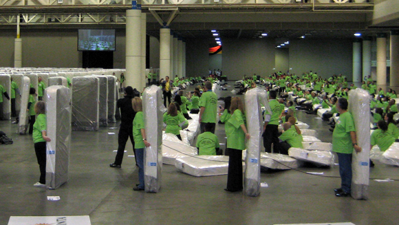 Video: Largest human mattress dominoes world record tumbles in the US