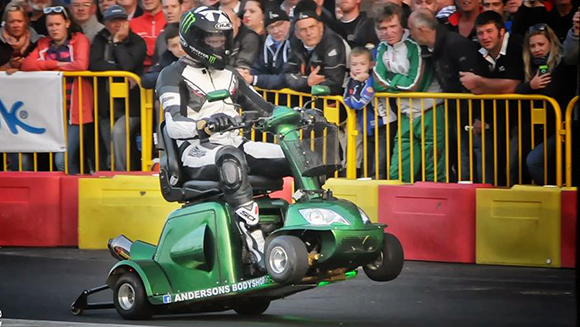 Video: Watch two mechanics race into the record books on a mobility scooter