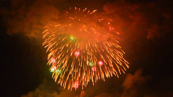 Boom! Watch the world's largest aerial firework shell explode during Japanese festival