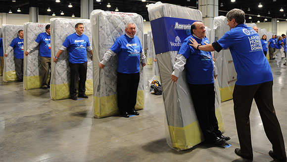 Video: Largest human mattress dominoes world record gets toppled in the US