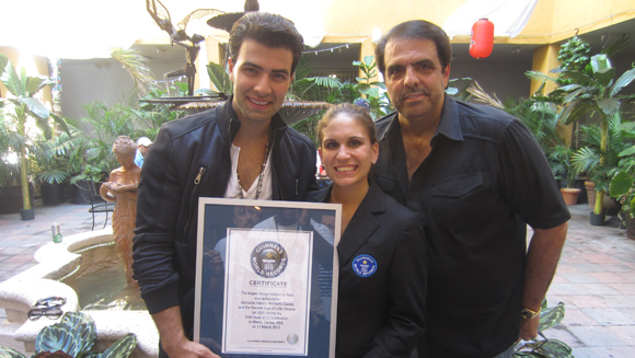 Latin singer Jencarlos Canela helps set new largest flag image record at Calle Ocho festival in Miami