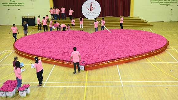 Singapore charity creates world's largest artificial flower bouquet