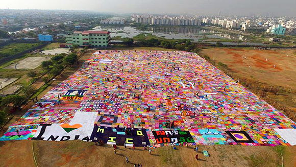 Indian women make largest crochet blanket ever then donate it to charity