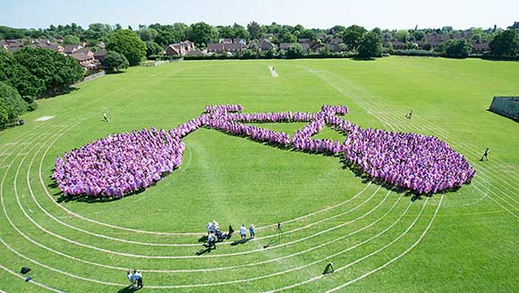 Warwickshire kids create largest human image of a bicycle ahead of local cycling race