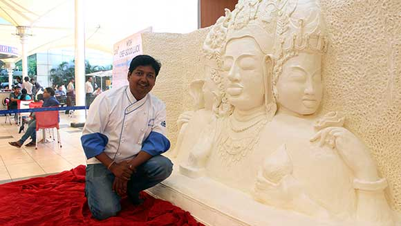 Indian chef makes record-breaking margarine sculpture of the Trimurti
