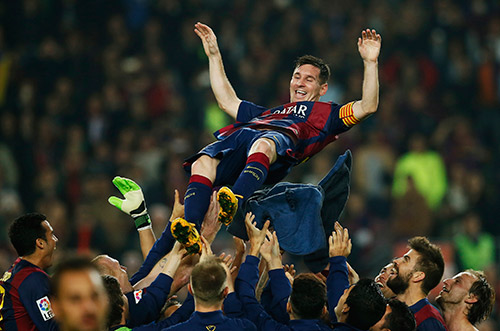 Lionel Messi celebrates with Barcelona teammates