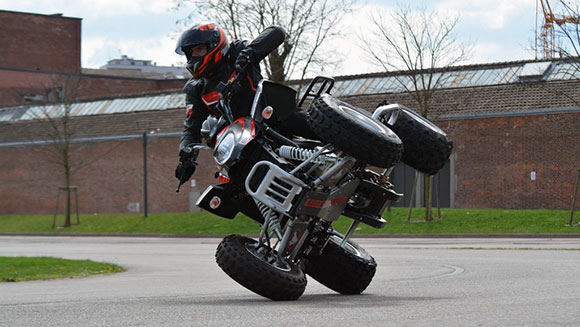 Watch amazing video of Frenchman breaking longest quad bike side-wheelie record
