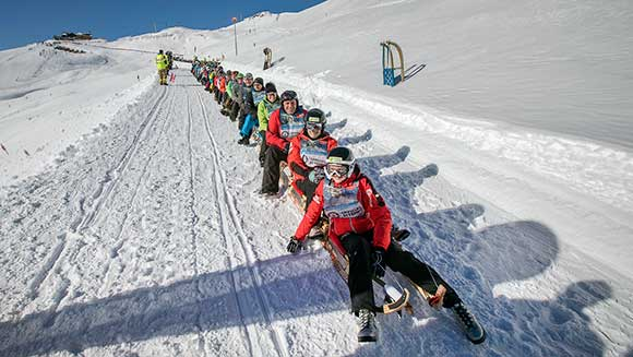 WYSIWYG test Austrian ski resort hosts world record attempt at the longest chain of sleds