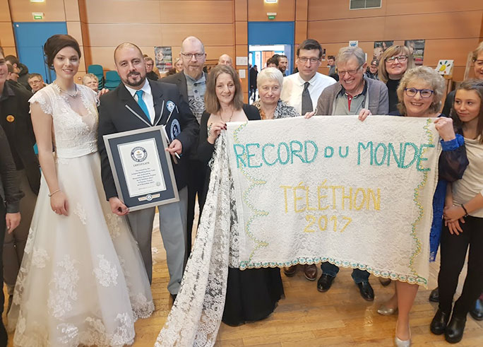 Longest wedding dress train certificate presentation