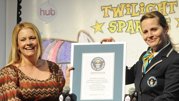 Melissa Joan Hart accepts Guinness World Records certificate for largest colouring book