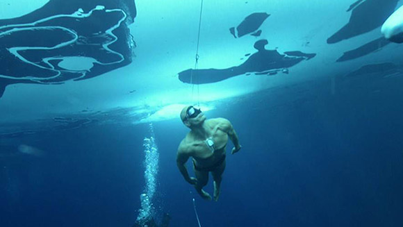 Stig Severinsen sets world record double with pair of daring freedives beneath the ice