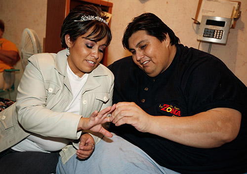 Manuel Uribe with wife.jpg