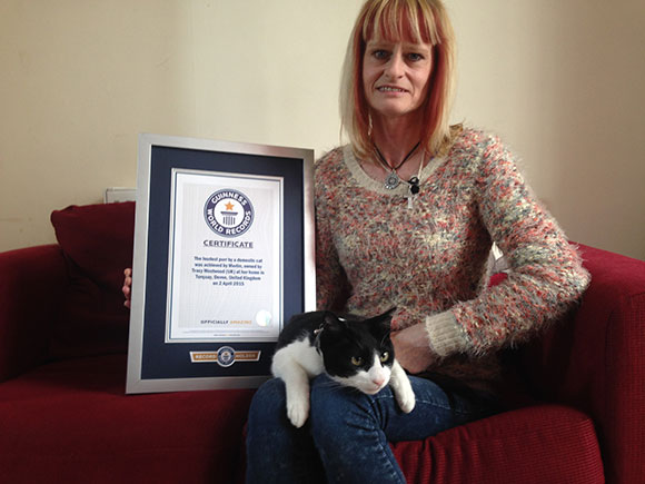 Merlin The Cat with owner and certificate