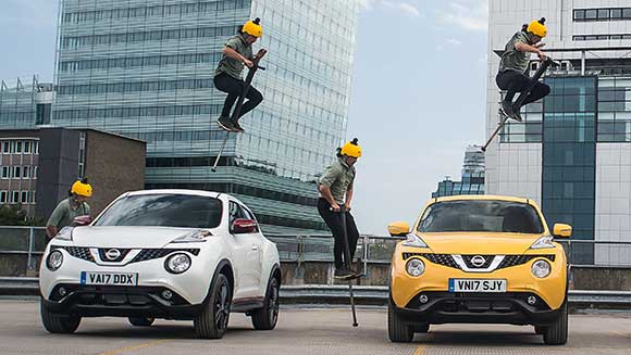 Video: Extreme pogo performer bounces over three Nissan cars for world record