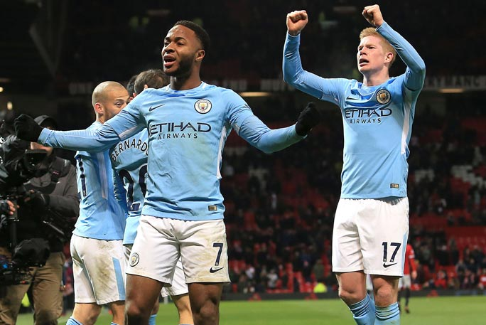 Manchester City celebrate winning at Old Trafford on their way to securing the most consecutive wins by a team in the top division of English football (soccer). Credit: Shutterstock
