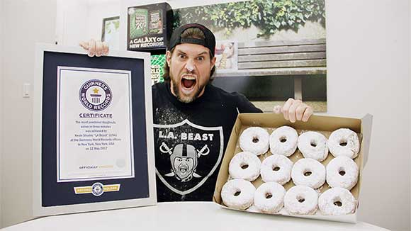 Video: Competitive eater and YouTube star L.A. Beast gobbles doughnut and maple syrup world records