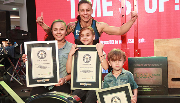 Most pull ups in 24 hours Eva Clarke with her children and certificates
