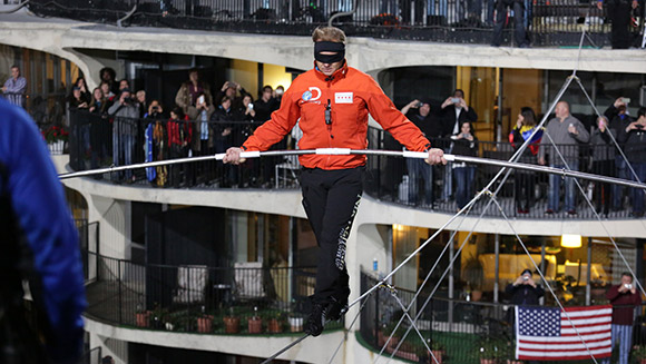 Double tightrope records for Nik Wallenda as daredevil walks between Chicago skyscrapers blindfolded - watch