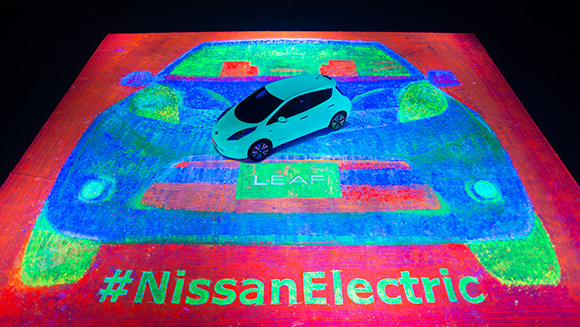 Nissan LEAF car used as a paintbrush to create largest glow-in-the-dark painting ever