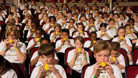 Schoolchildren break ocarina world record at London's Royal Albert Hall