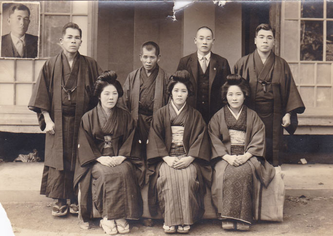 Kane (front row, centre) with her brothers and sisters