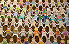 Watch time lapse video of the making of the world's longest paper doll chain