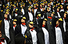 (VIDEO) Largest gathering of people dressed as penguins descends on London's Canary Wharf for world record