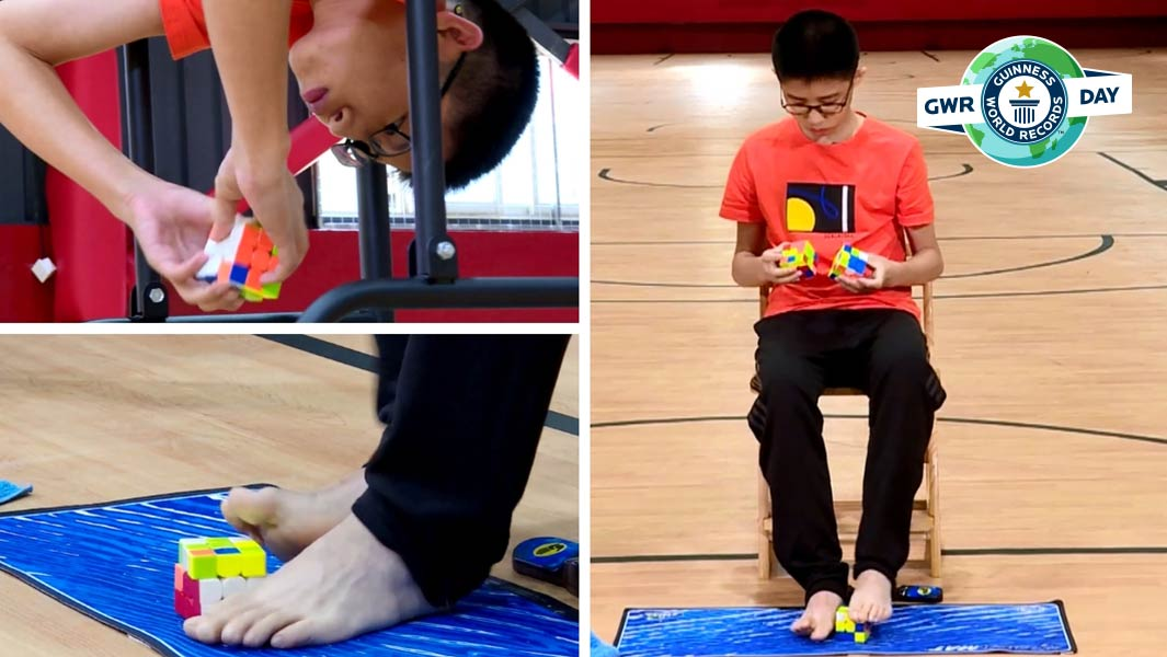 Que Jianyu solves three Rubik's cubes at the same time - one with each hand and a third with his feet