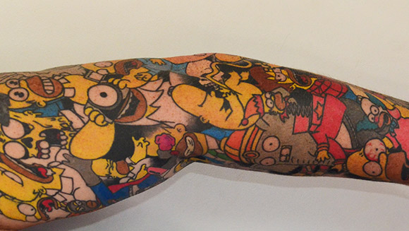 In pictures: Simpsons fan sets cartoon character tattoo record with Homer tribute
