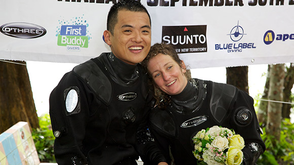 How deep is your love? Couple set underwater wedding world record