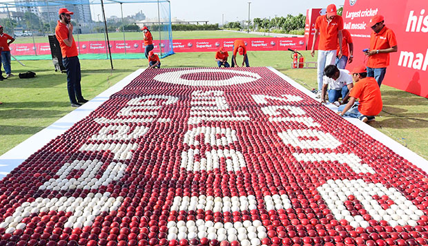 Vodafone India employees building largest cricket ball mosaic