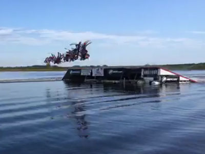 Waterskiers front flip