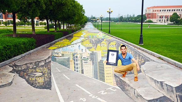 In pictures: Incredible 3D street art sets anamorphic painting records in China