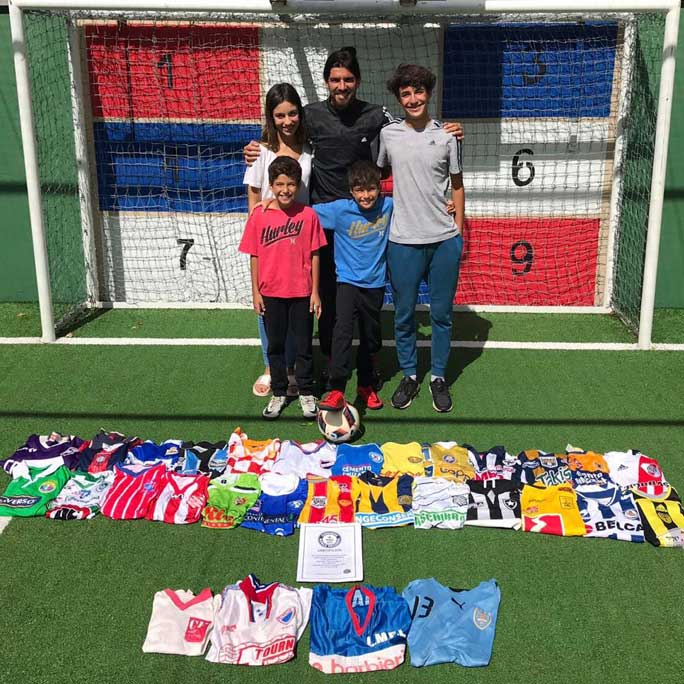 Sebastian Abreu with his certificate and a shirt from every club he's played for