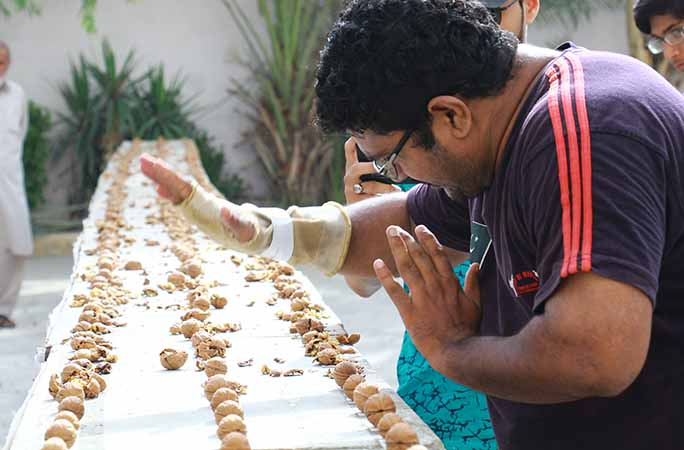 close-up-of-Muhammad-Rashid-during-attempt-for-most-walnuts-crushed-by-the-hand-in-one-minute.jpg