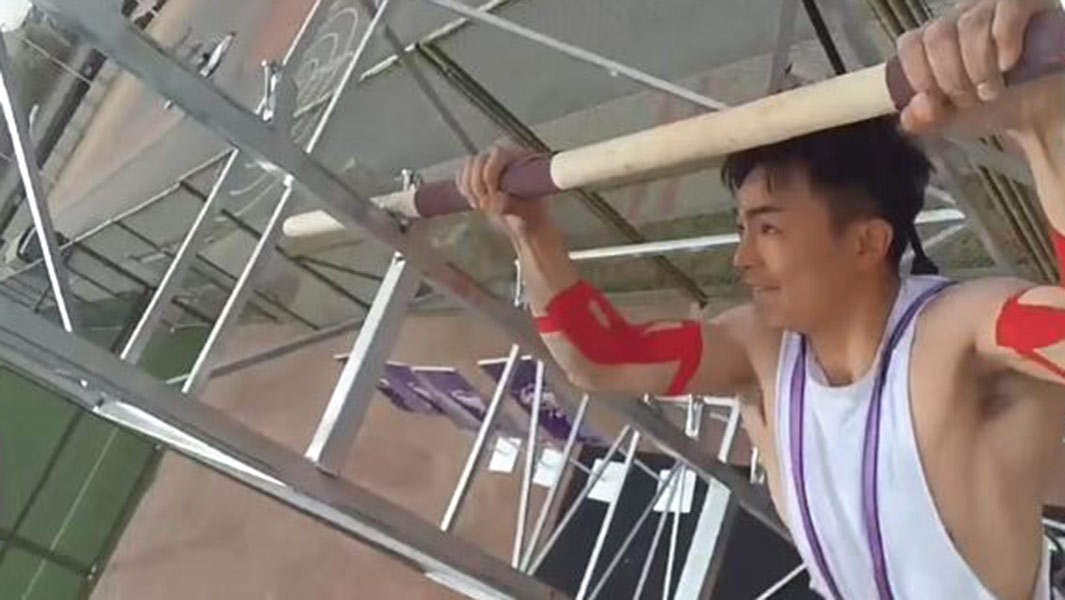 Pull ups record holder raises the bar as he ascends tower while completing demanding exercise