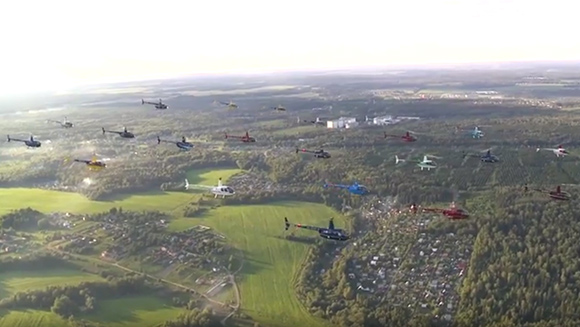 Spotlight: Russian pilots take to the skies for spectacular largest helicopter formation flight