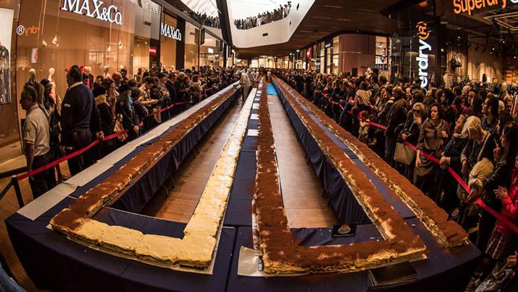 The longest tiramisu measures 273.50 m (897 ft 3 in) and was prepared by Galbani Santa Lucia (Italy), in Milan, Italy