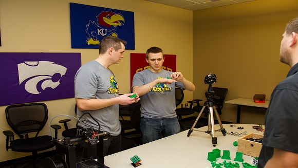 Robot created by software developers solves Rubik's cube in record time