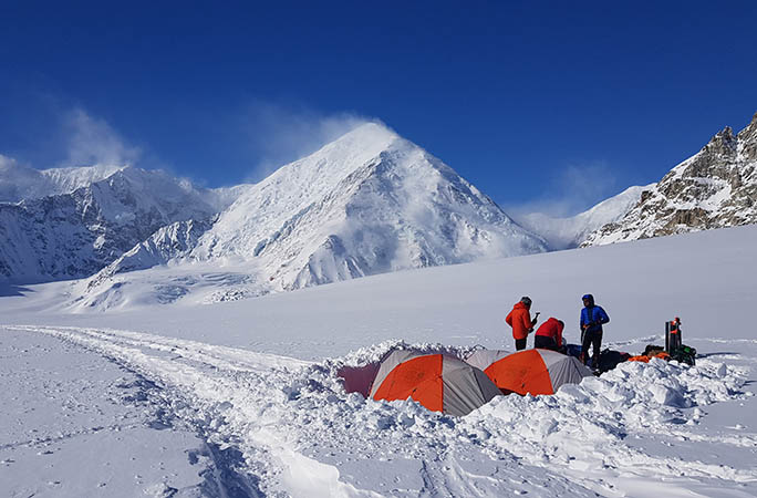 Tents partially submerged in snow on Mount Everest