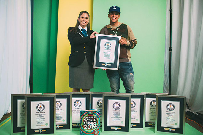 Daddy Yankee with his 10 Guinness World Records certificates