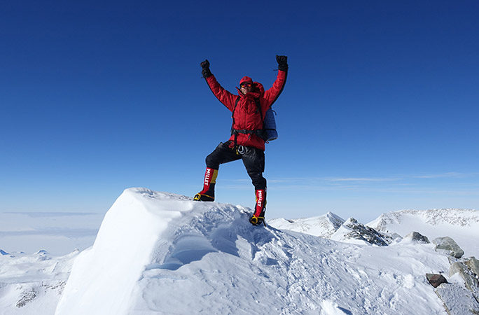 Daniel-Bull-celebrating-on-summit.jpg